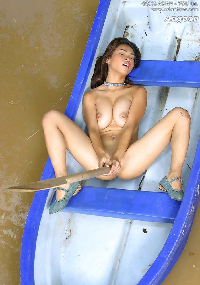 Naked girl on a boat