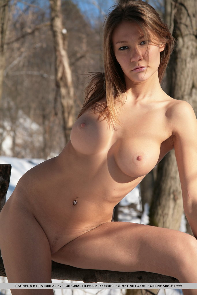 Naked girl outside with toys
